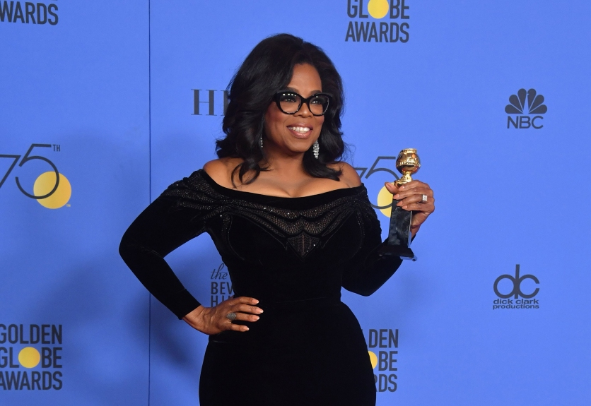 Actress and TV talk show host Oprah Winfrey poses with the Cecil B. DeMille Award during the 75th Golden Globe Awards on January 7, 2018, in Beverly Hills, California. / AFP PHOTO / Frederic J. BROWN (Photo credit should read FREDERIC J. BROWN/AFP/Getty Images)
